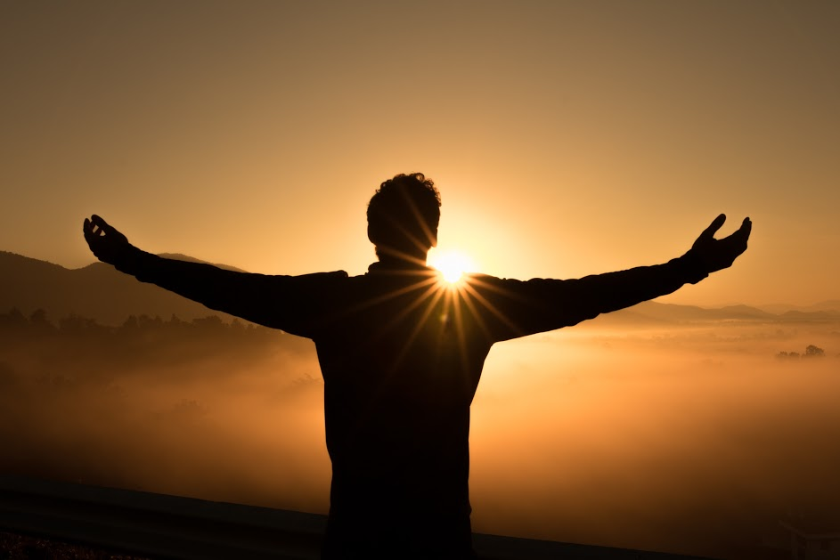sunrise and man praising