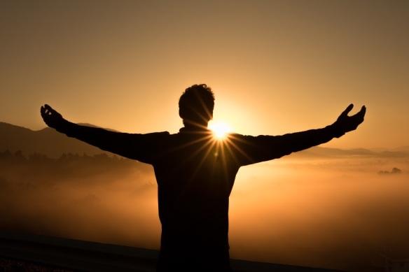 sunrise and man praising